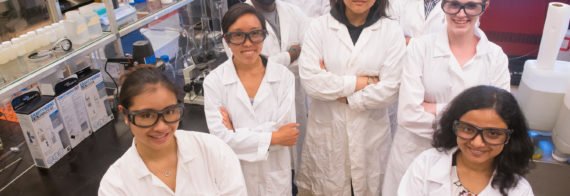 A group photo of the Genecis team in a lab