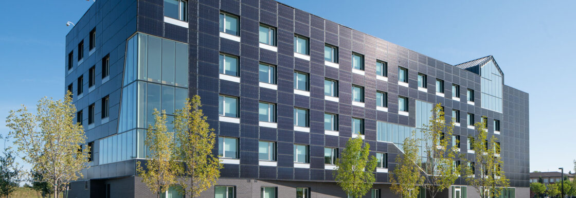 New Residence Southwest Corner Showing Exterior Solar Panel Cladding and High Performance Building Envelope